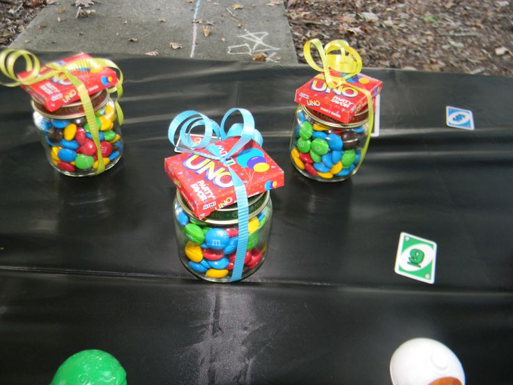 Easy treat for guests for an UNO themed first birthday party. M&M's in a baby food jar with Mini UNO cards on top. I found the mini UNO cards at Party City.