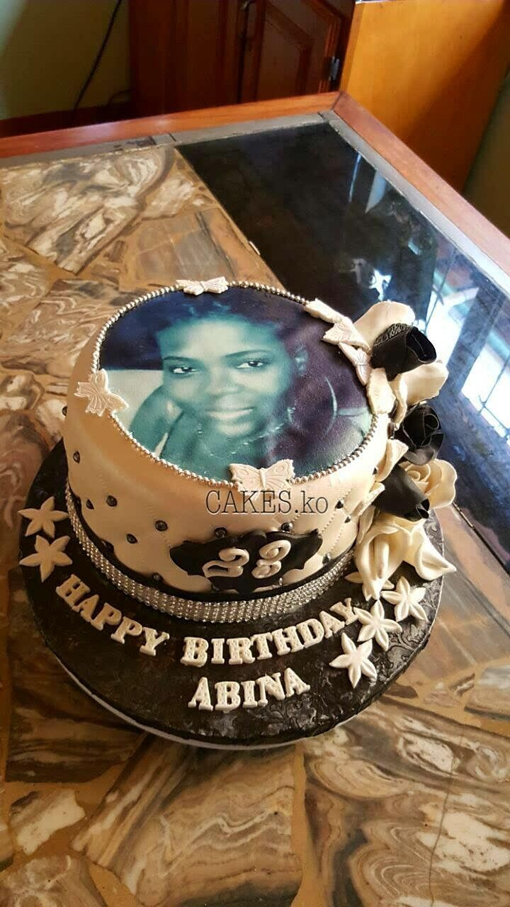 Beautiful black and white birthday cake. Click link to my business page for more of my work.