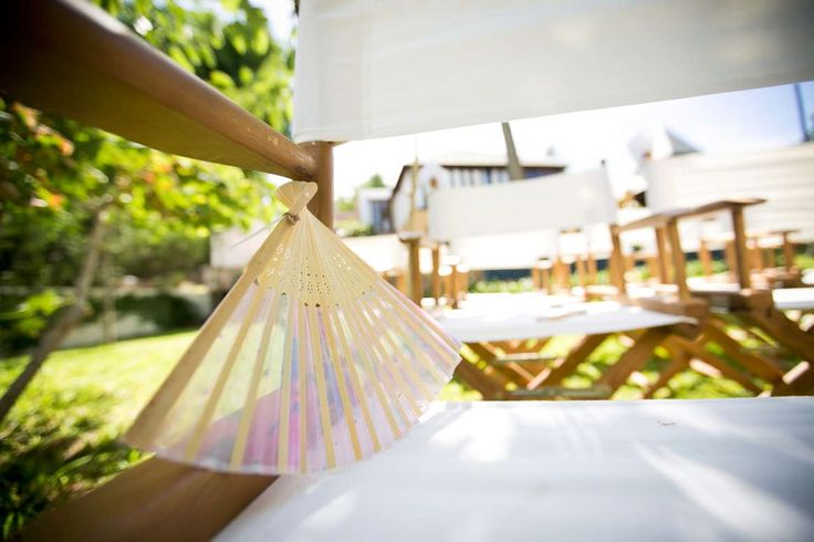 Directors chairs in the garden at Pawanthorn. Don't forget the personalised fan to keep your guests cool