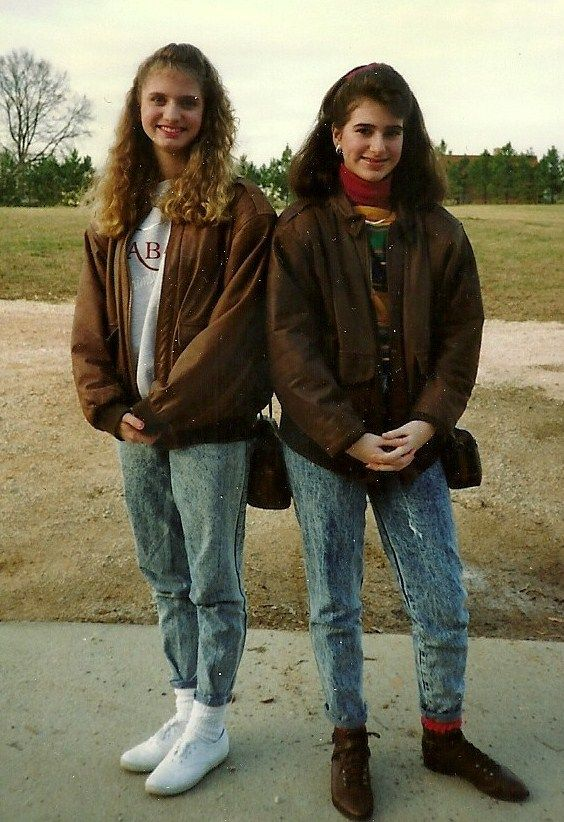 Here is the most true representation I've seen so far of how we REALLY dressed in the late '80s/early '90s: leather bomber jackets and acid-washed jeans stuffed into socks, with Keds. And bad perms.