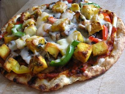 Paneer Tikka Pizza on Naan Bread. An experiment from a while back that was a stunning success.