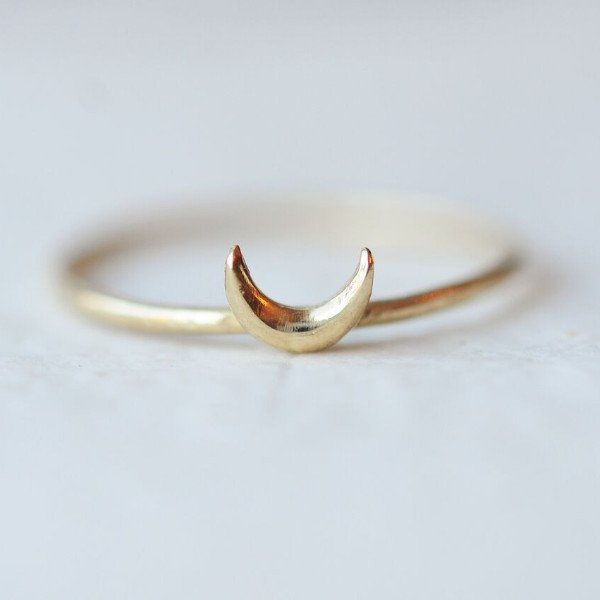 This handmade crescent moon ring is the perfect stacking piece to add to your collection. Available in 14k yellow gold or sterling silver.
