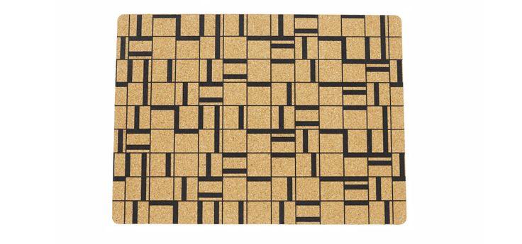 Asphalt placemat in cork. Designed by Anne Stensgaard.