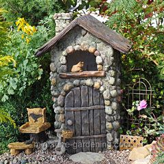 Cute idea.  Take a bird house and paint it and glue stones and twigs to it :)