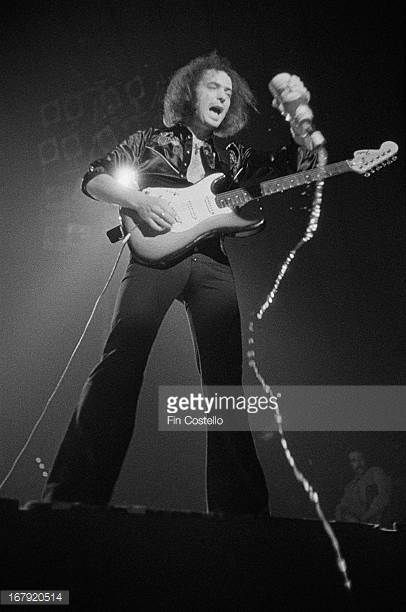 Guitarist Ritchie Blackmore from Deep Purple performs live on stage using a bottle as a slide during the band's American tour in November 1974