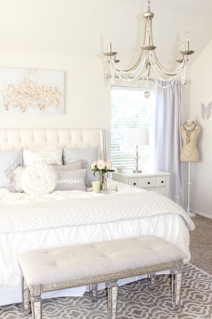 Updated Vanity and master bedroom tour. Bright white bedroom tufted headboard pintuck west elm duvet Oliver gal candelabro canvas art shabby chic French cottage style glam cozy feminine elegant crystal chandelier romantic homes neutrals zgallerie pillows ruffle ruffle throw blanket fresh flowers blush.