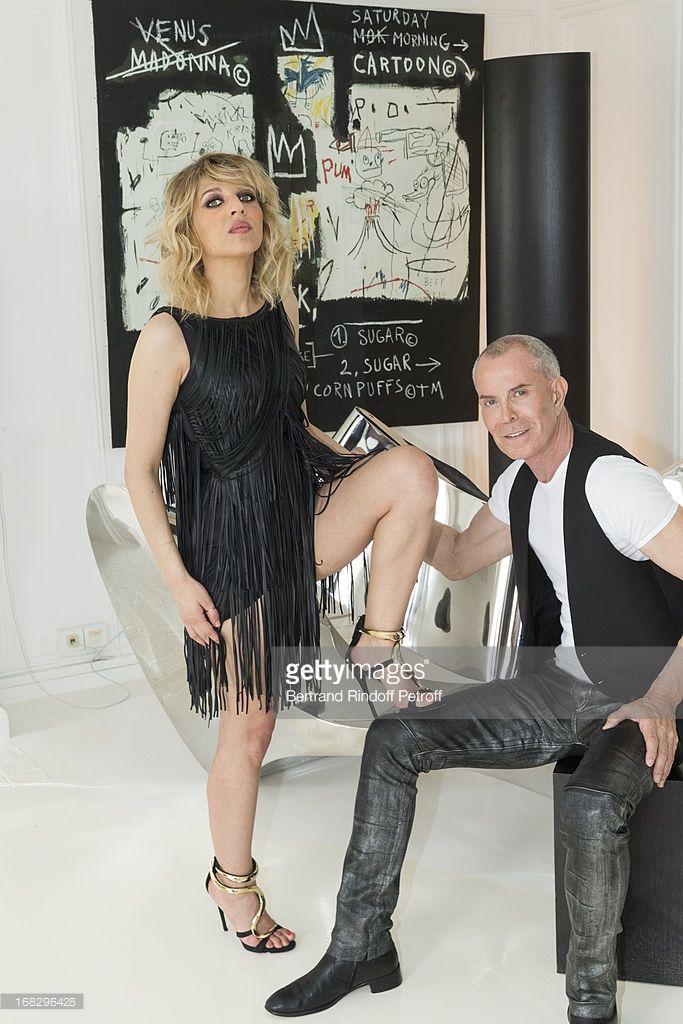 Photo d'actualité : Singer Amandine Bourgeois , wearing a dress...