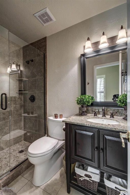 Traditional 3/4 Bathroom with frameless showerdoor, Undermount Sink, Complex Granite, Home Classics Woven Wicker Basket