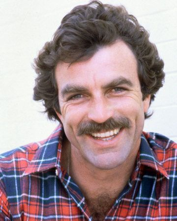 Tom Selleck…so cute/••••This is the Tom of Magnum P.I. Days.  With his little boy side shining through.