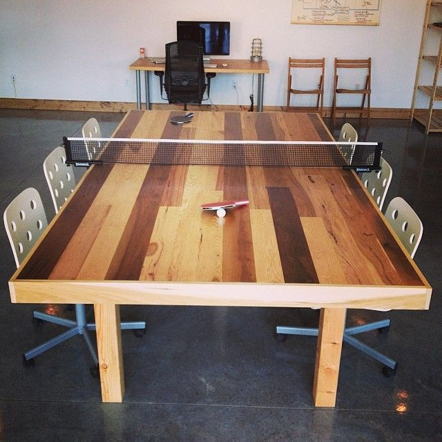 DIY, conference / ping pong table we built out of reclaimed hardwood floor planks for our studio space. www.demicreative.com