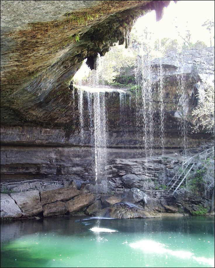 This is Hamilton Falls, which is located 30 miles outside of Austin Texas :)    http://attractions.uptake.com/blog/hamilton-pool-nature-preserve-texas-2601.html