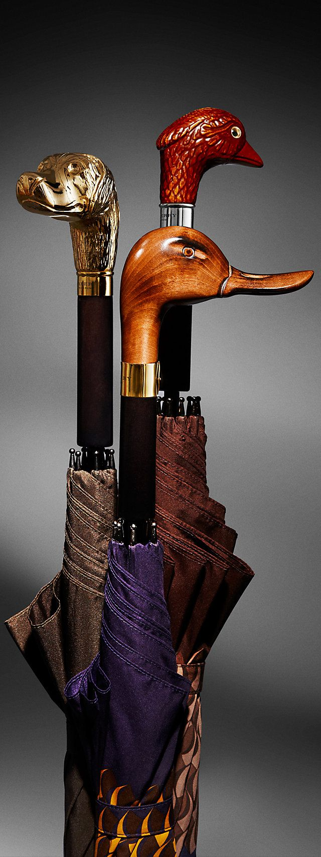 Burberry umbrellas...notice the flow of the grain on the duck's head. Gorgeous...  repinned by www.smg-treppen.de