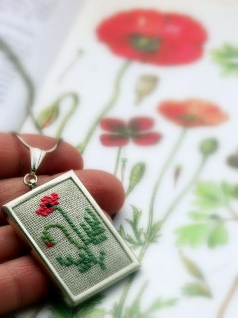 cross stitch pendant with red poppy
