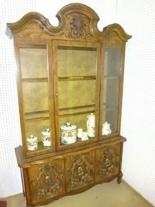 "China cabinet for sale This cabinet is 50""Wx16""Dx81""H The 2 upper display shelves are made for glass but the glass is missing Only the center section opens in the upper section and the center panel in the lower section does not open"