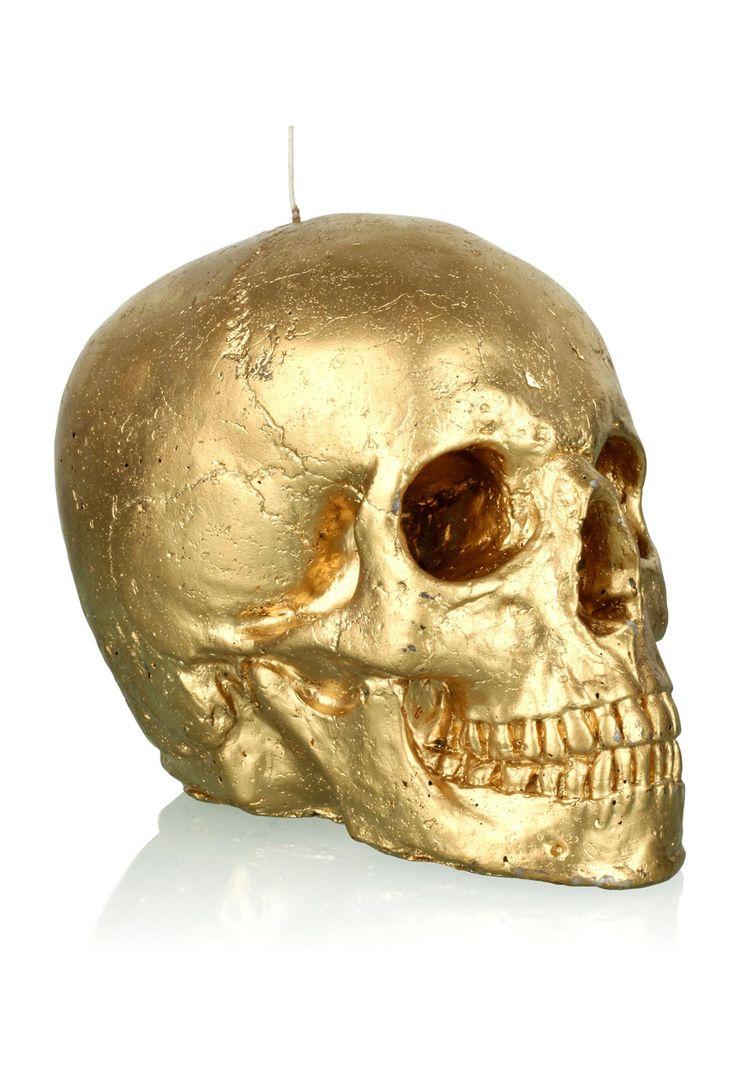 kultainen pääkallokynttilä