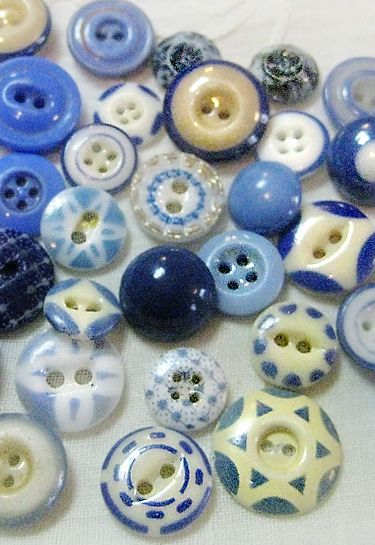 Antique blue and white, calico and china buttons.    My mom's button box was magic jewels when I was growing up. It still is.