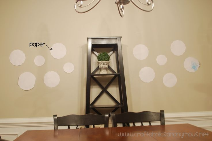 DIY on using paper cutouts of plates to arrange them on the wall with just 1 nail per plate!