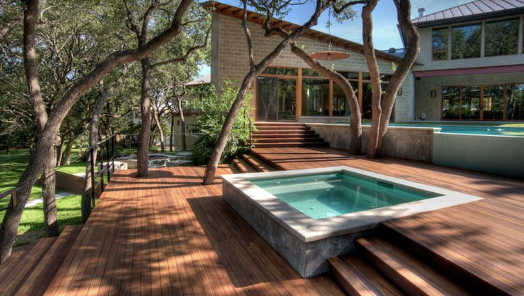 A Square Hot Tub Is Built Into Slatted Deck Providing A