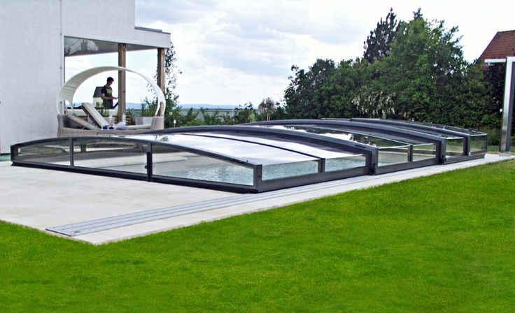 This low pool enclosure VIVA by Alukov has moden looks :-)