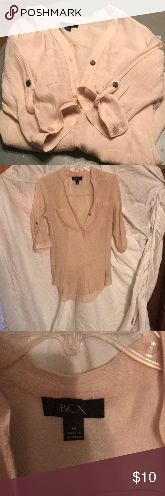 Blouse cream women's top Really beautiful 2 button up  cream blouse loose fit . size medium cream color.. just bought but doesn't fit me well.. BCX Tops Button Down Shirts