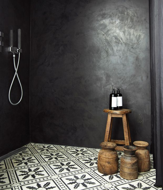 Black walls and Moroccan tiles in the bathroom