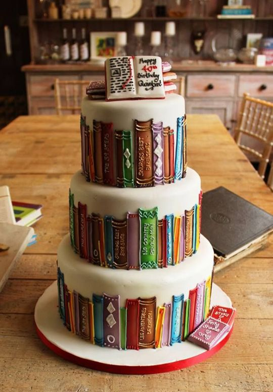 If you love books, then this is your cake… other than the unfortunate fact that Fifty Shades of Gray is laying at the bottom of it,  that just needs to change.... I'd want good books on my cake,  not porn.