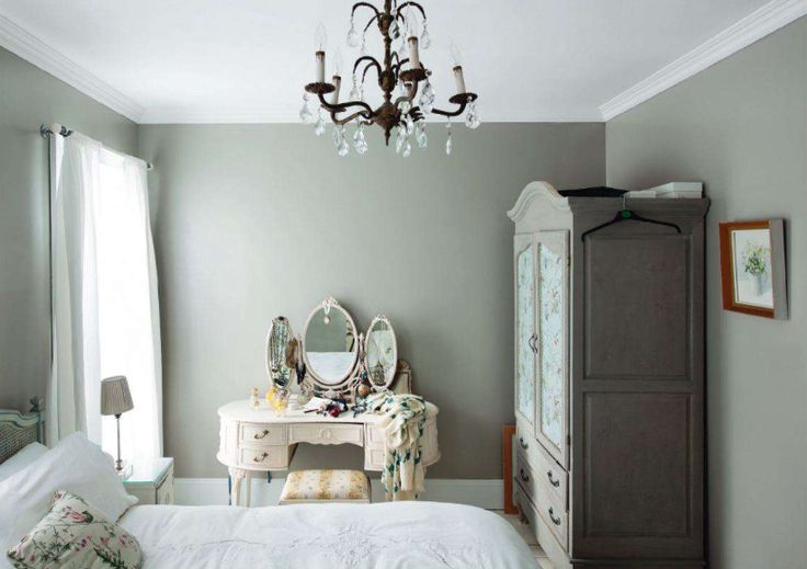 For French furnishings, look to a decoratively carved or painted armoire (the most important furniture piece in provincial homes, armoires can be traced back to the 14th century and can serve today's needs by housing your TV). Chandelieres and ornate vanities add to the style. #bedroom #French