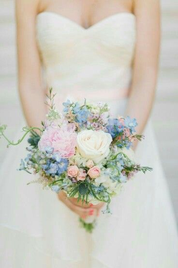 Romantic Bridal Bouquet Featuring White Hydrangea, Blue Delphinium, White Garden Roses, Pink Peonies, Pink Roses, Pink Spray Roses, Pink Astilbe, Blue Eryngium Thistle, Light Lavender Waxflower