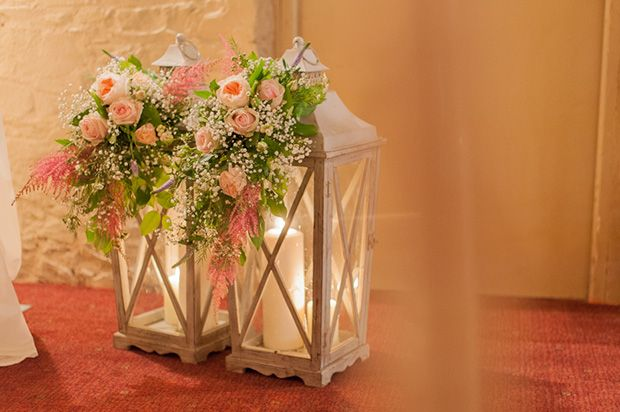 pretty lanterns with florals | Paul and Ann's pretty barn wedding at Larchfield | www.onefabday.com