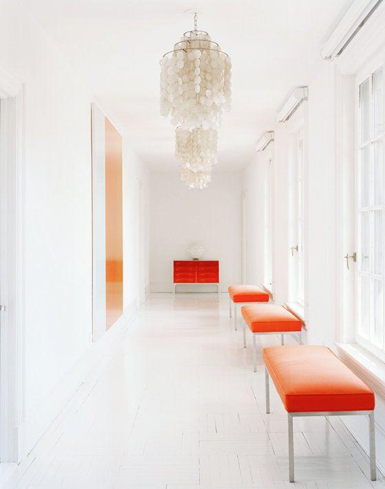 Photograph by Douglas Friedman: Friedman Photography, Orange, Benches, White Spaces, Capiz Shells Chandeliers, Douglas Friedman, Hallways Lights, Offices Colors, Pendants Lights