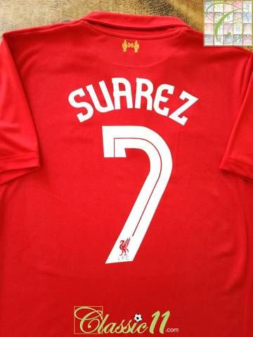 487413491 Official Warrior Liverpool home football shirt from the 2011 12 season.  Complete with Suarez  7 on the back of the shirt in official European  lettering.