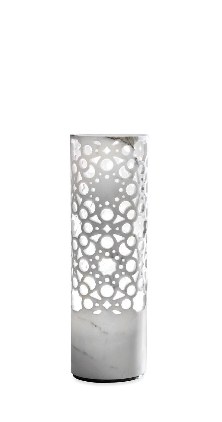 EGO MARMO - A new marble version of Ego has been presented by Martini Light with Budri and has been engraved with the typical pattern of interiors and cloths