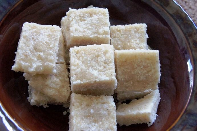 RECIPE FOR RAVA COCONUT BARFI Ingredients •	Sooji / Rava - 1 cup •	Grated coconut - 1 cup •	Sugar - 1 3/4 cup or 2 cups if you want it to be sweeter •	Ghee - 2 tablespoon •	Powdered Cardamom - 2tsp