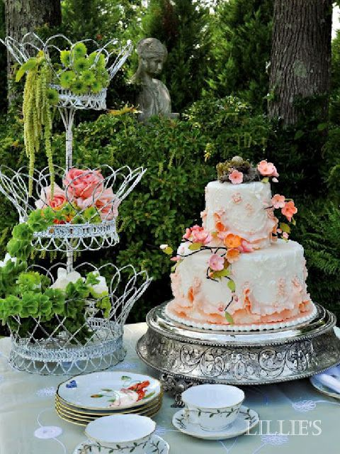 Tiered Dessert Tray filled with floral arrangements and a beautiful spring cake pulls this table together nicely.