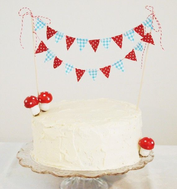 red blue cake bunting and toadstools