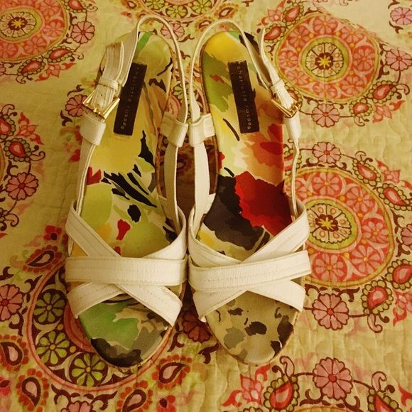 White strappy sandal with wedge Nothing says spring time like a cute pair of white wedges! These cute strappy sandals are in good condition and are a must have for the closet. Make them yours today. Charlotte Russe Shoes Wedges