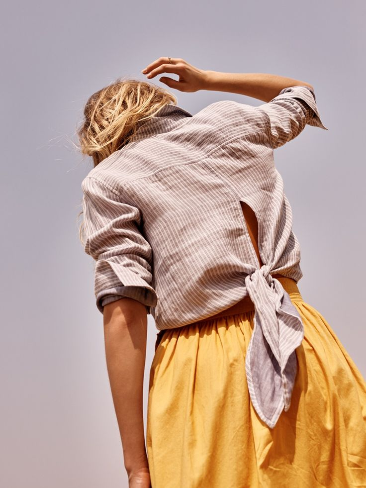 madewell striped tie-back shirt worn with the side-button skirt.
