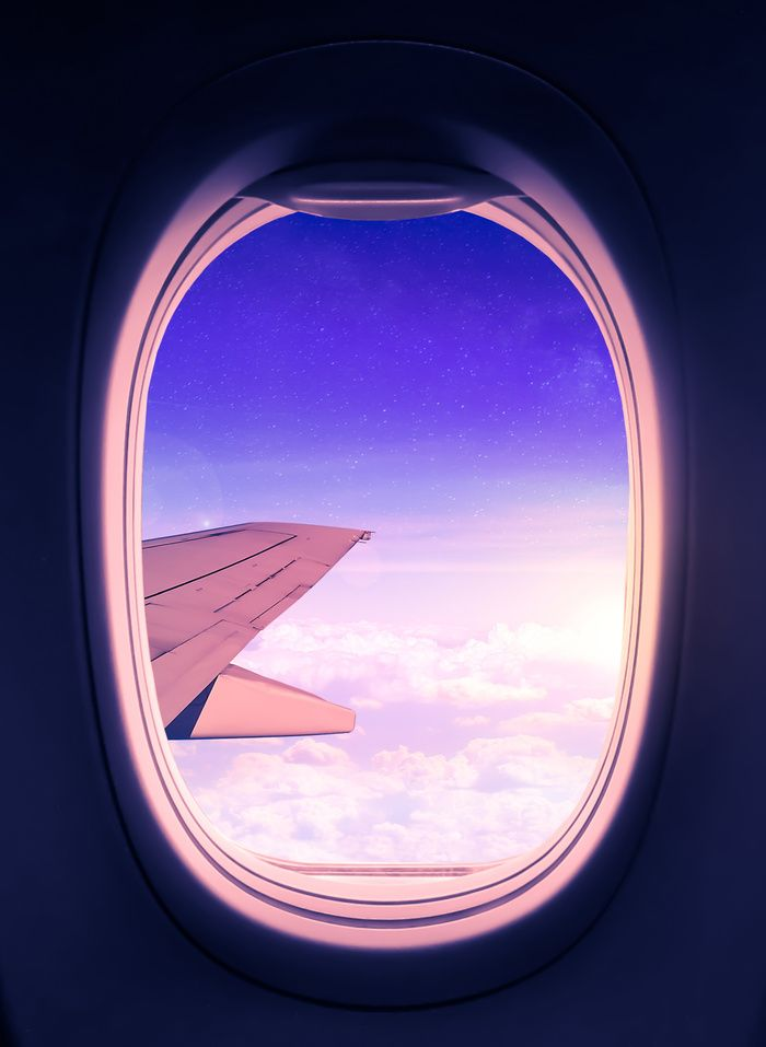 Travel the World. Magical view from an airplane window with the sun glowing over the clouds and the star filled sky. Edited in Photoshop and Lightroom. #adventure #wanderlust #travel #airplane #window #sky #stars #clouds #window #purple