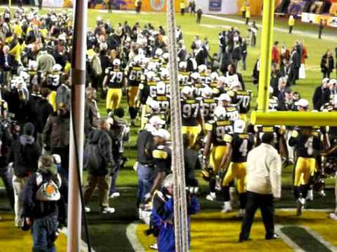 Iowa fight song & in heaven there is no beer by the band at the Orange Bowl