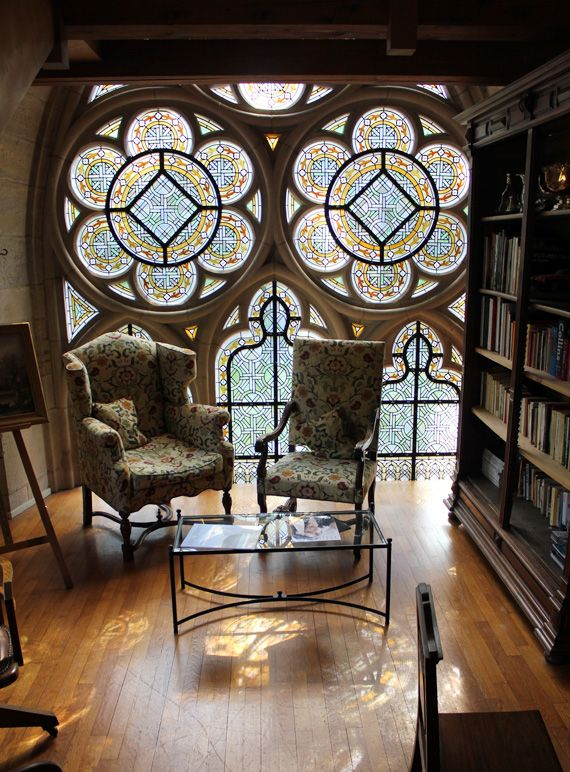 Reading nook with stained glass windows in L'Abbaye de la Bussière, Burgundy, which has been converted to a hotel #books #France