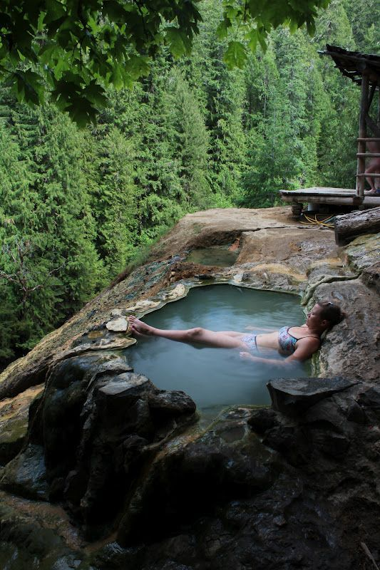 """The Umpqua Hot Springs Trail is a short 0.3 mile hike to the springs. A """"tub"""" is hewn out of the travertine deposits surrounding the springs. The springs, at a temperature of 108 degrees, is located on a bare rock face 150 feet above the North Umpqua River. From the tub, there is a view of Surprise Falls across the river."""