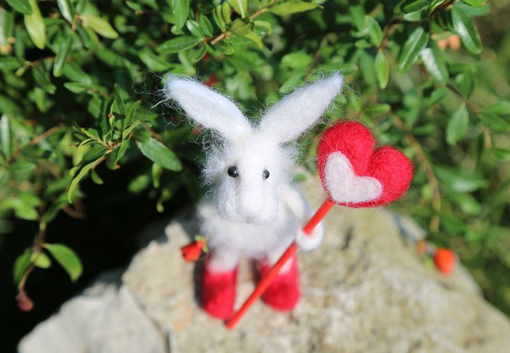 Needle felted white bunny/rabbit/hare. With needle felted lollipop. Cute and funny. by donidinadya on Etsy