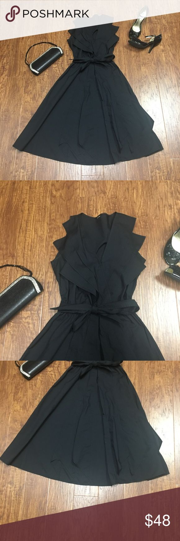 Black wrap style fit & flare dress Beautiful black dress... like new. No tags. Purchased from Victoria's Secret catalog a few years ago. Fits a 6-8 or medium Victoria's Secret Dresses