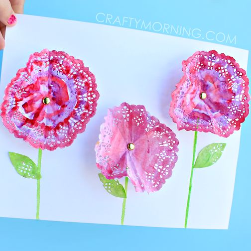 Make some beautiful doily flowers for a spring craft!