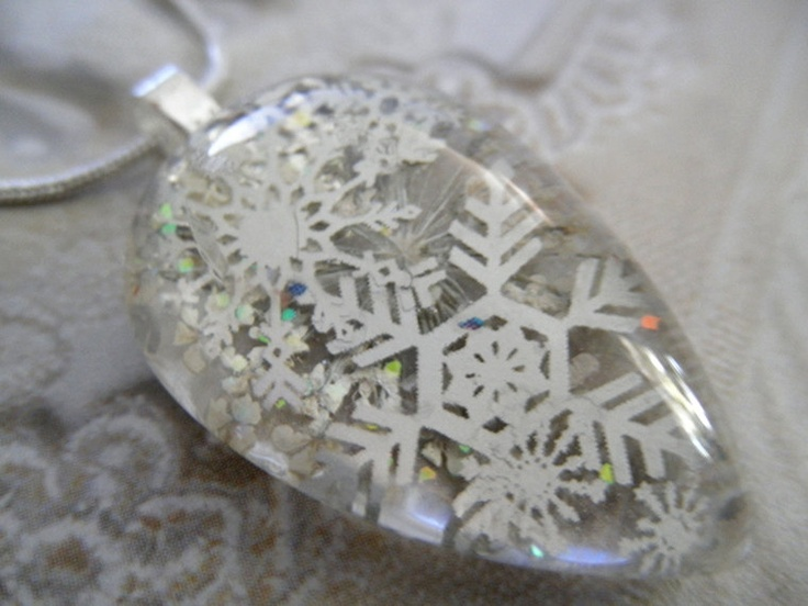 Peaceful Snowfall-Pressed Flower Glass Teardrop with Silver Snowflakes, Queen Anne's Lace, Hologram Color Change Glitter-Symbolizes Peace. $23.00, via Etsy.
