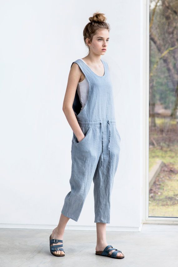 Washed and soft linen jumpsuit. As mostly all of our items in the shop the jumpsuit is of rather loose fit, so if you want more fitted look, you may order one size down. The model is 170 cm high and the model is wearing size S (8 UK). The inner seam of the pant part - about 50 cm (+/- 1-2 cm). Our items are made of washed linen fabric, specially woven for us by our local linen manufacturers. The procedure of making these items takes time and effort, cause the items are double washed once…