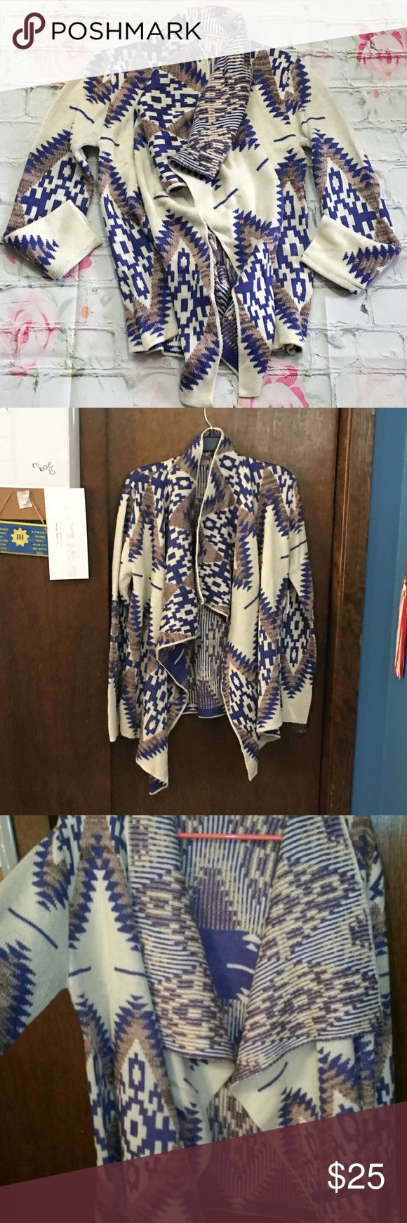 """Tribal Print Cardigan New with tags. Charlotte Russe Tribal Print Cardigan with cream, blue, and brown colors. It is 22"""" from armpit to armpit laying flat and about 25"""" long.  Pet Friendly Home, Smoke Free Home , No trades. Offers, Bundles, and Questions Encouraged Charlotte Russe Sweaters Cardigans"""