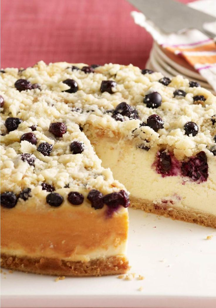 PHILADELPHIA Blueberry Streusel Cheesecake – This sweet summer dessert recipe the best of both worlds: a dense, creamy filling of cheesecake along with a blueberry streusel crumble crust and topping.