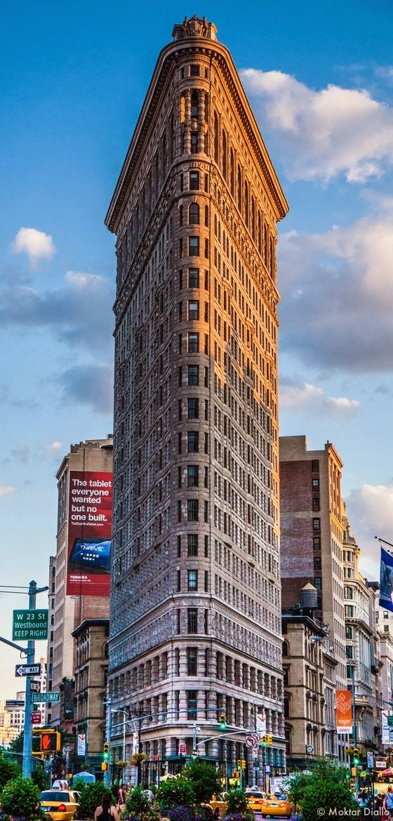 The Flatiron Building, originally the Fuller Building, is located at 175 Fifth Avenue in the borough of Manhattan, New York City, and is considered to be a groundbreaking skyscraper. Upon completion in 1902, it was one of the tallest buildings in the city and one of only two skyscrapers north of 14th Street – the other being the Metropolitan Life Insurance Company Tower, one block east.