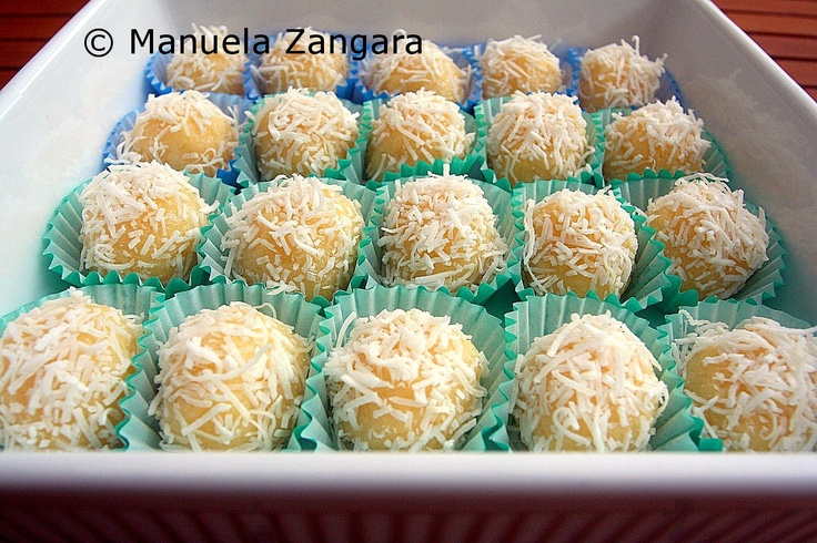 Beijinhos de Coco - Brazilian coconut kisses. Much like Brigadeiro, only coconut instead of chocolate. A must for anyone who like dulce de leche.